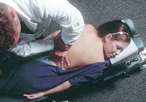 Chiropractor relieving pain;
