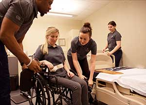 OTA students in simulated home care environment;